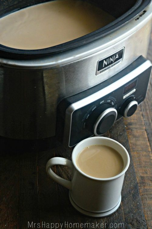 A crockpot full of lattes & a cup with some it in too