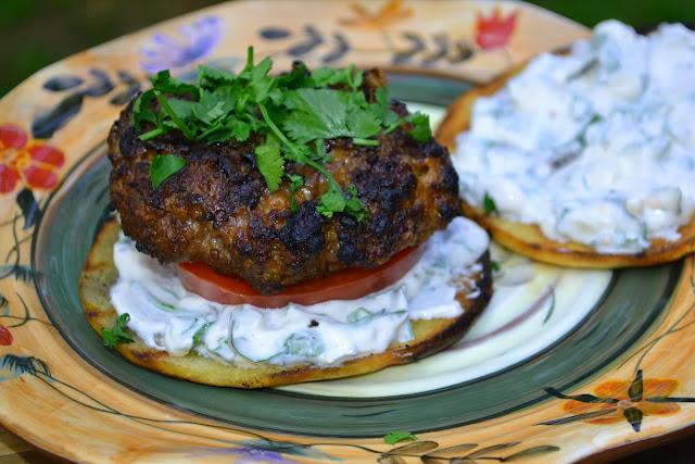 burgers with cilantro garlic sauce and cilantro garnish
