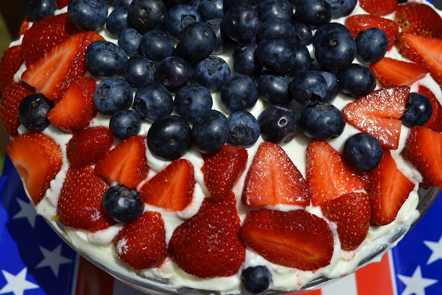 triple berry trifle with blueberries and strawberries