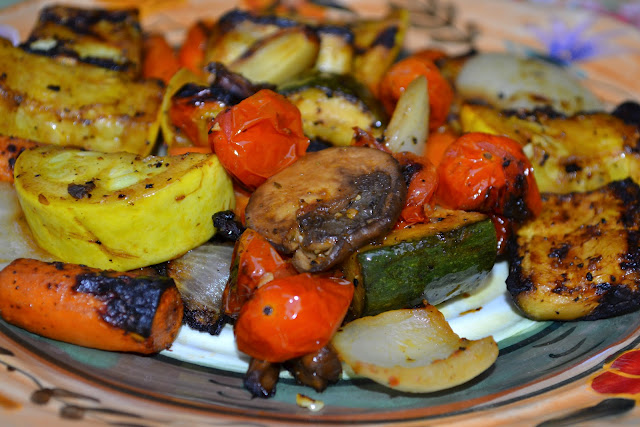 balsamic roasted vegetables on a plate - carrots, onions, zucchini, squash