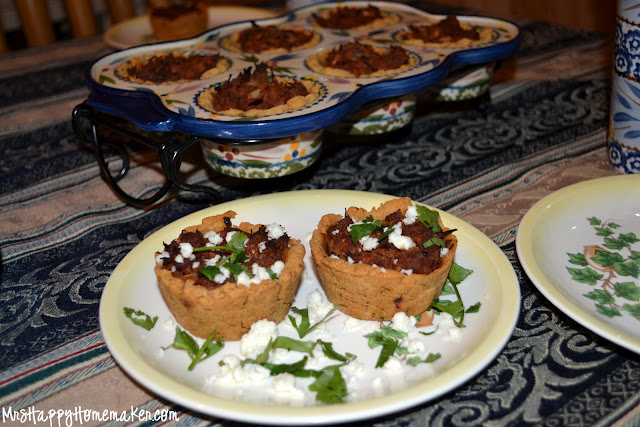 tamale cups - some on a plate, some in the muffin pan