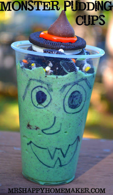 Monster Pudding Cups - green pudding topped with Oreos with clear plastic cups decorated with a black sharpie