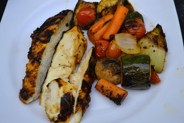 balsamic roasted vegetables on a plate - carrots, onions, zucchini, squash  with chicken