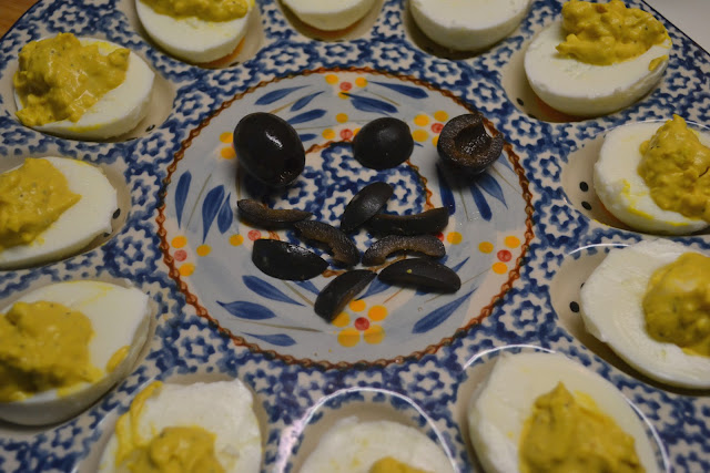 deviled eggs and sliced black olives to make the legs for the deviled egg spiders