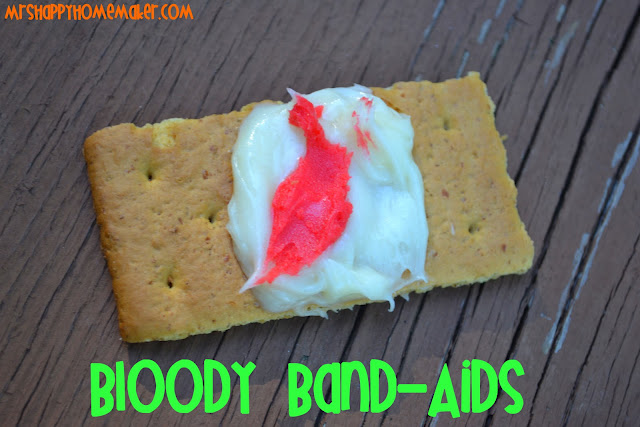 Blood Band Aid graham cracker cookies made from graham crackers, frosting, and red food coloring