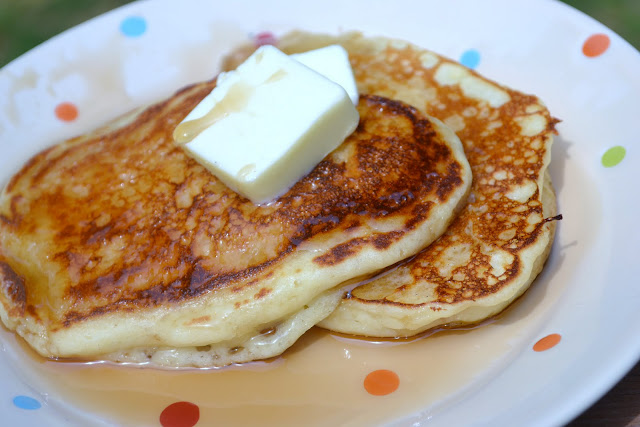 buttermilk pancakes with butter and syrup