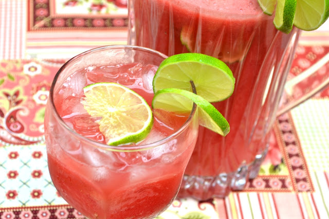 Watermelon Agua Fresca garnished with fresh lime slices