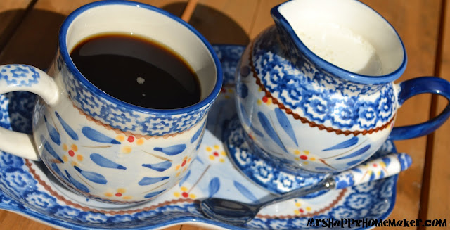 French Vanilla Coffee Creamer in a mini pitcher with a cup of coffee - matching blue dishes