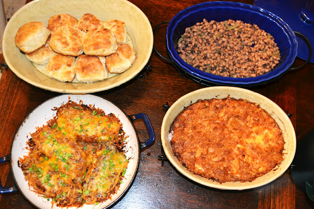 baked bacon cheddar pork chops with biscuits, squash casserole and black eye peas