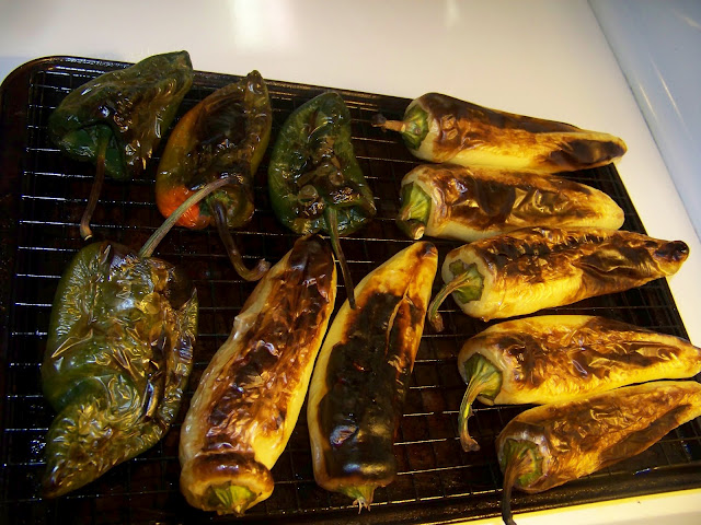 charred poblano and banana peppers on a baking rack