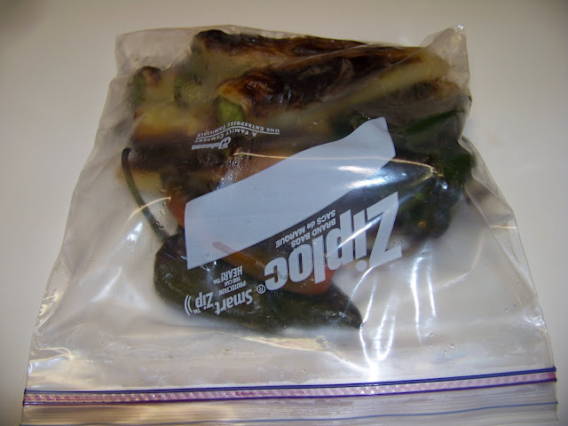 charred peppers inside of a plastic ziploc bag